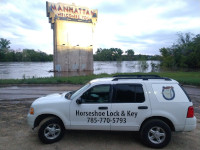 Locksmith Vehicle in front of City Of Manhattan Welcome Sign